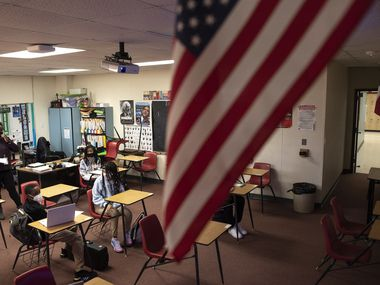 An American flag hangs in the room of an eighth grade American history class as the students discuss the Presidential candidates and the 2020 election during, on Wednesday, Nov. 04, 2020 at Permenter Middle School in Cedar Hill.