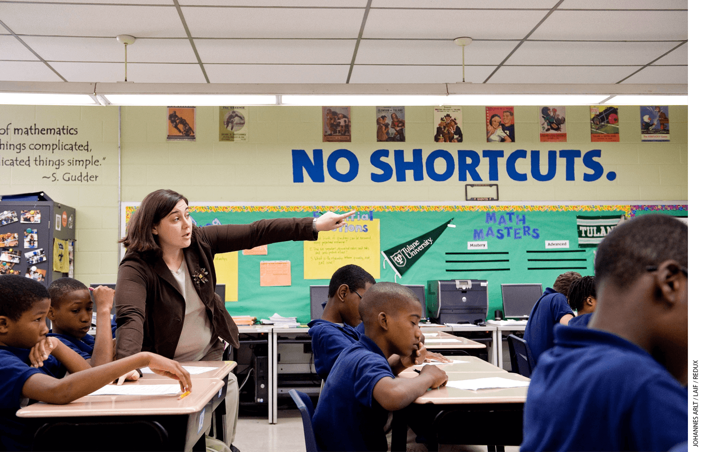 """Block letters on a classroom wall remind students that there are """"no shortcuts"""" at KIPP Believe College Prep in New Orleans, part of the KIPP network that pioneered the no-excuses model."""
